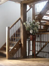 Textured drop forged wrought ironwork balustrade and Welsh oak staircases