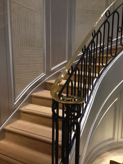 Circular cast iron staircase in Christian Dior retail shop in London.