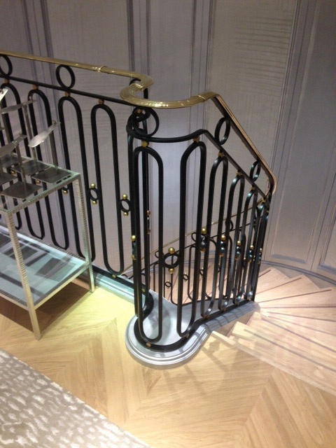Looking down the shop staircase with cast iron and brass stair balustrade.