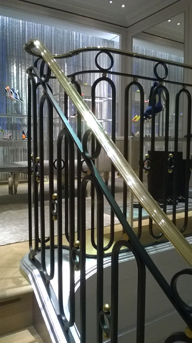 Decorative steel, iron and brass stair balustrade in London retail premises.
