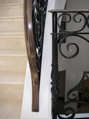 Brass staircase handrail finished in patinated bronze and waxed