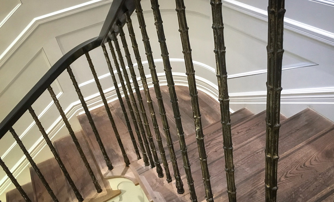 Shop staircase with cast iron baluster railings and oak stair treads.