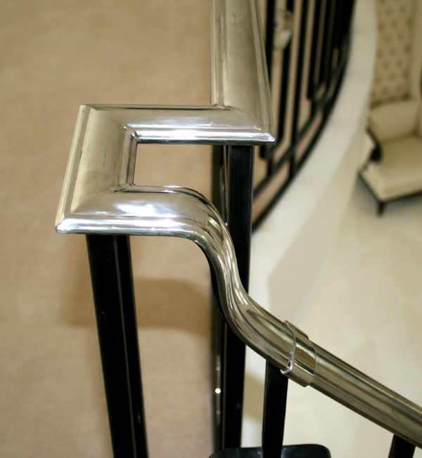 Close view of profiled and shaped stainless steel stair handrail