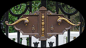Bronze handles on wrought ironwork traditional iron gates