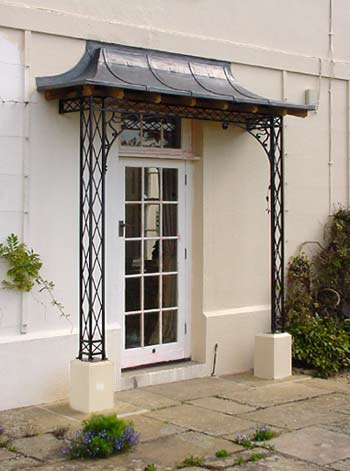 An Early Porch Project A Regency Style Metal Porch Awning on Natural Stone Plinths With Spandrel Brackets and a Lead Covered Canopy