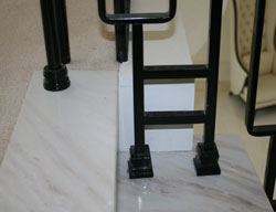 Balustrade fixed into marble stair treads