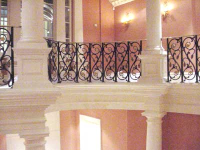 A stately home balustrade made from cast iron with brass handrails