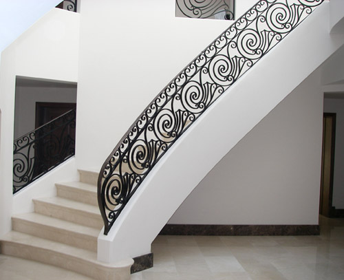 Forged mild steel metal staircase balustrade located in Wimbledon, London, UK