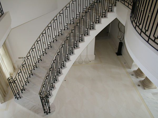 Marble staircase with balustrade and stainless steel hand rails