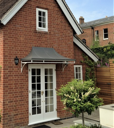 Contemporary style metal Canopy with Zinc Canopy Roof. A Simple Door Canopy solution over french doors