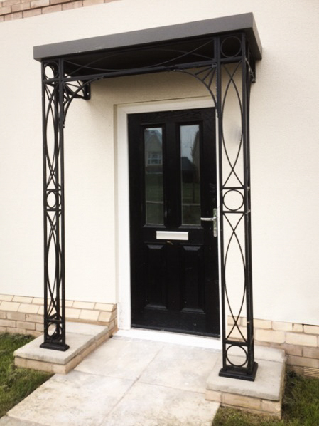 Front Door stylish Nouveau design Organic Metal Porch Portico Awning with a Flat Zinc Galvanised Roof Canopy Cast Aluminium Shoes and our sunray spandrel brackets