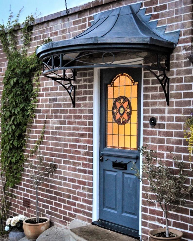Wrought iron door canopy