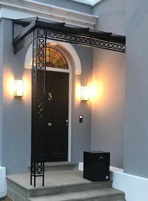 A Modern classic style Corner Metal Georgian design Porch Awning Portico with Glass Roof Covering a Georgian style front door with fanlight