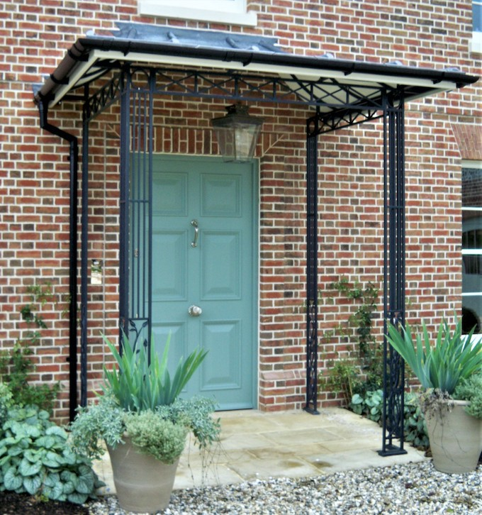 Traditional Roseleaf design Metal porch portico featuring Cast Iron organic roseleaf and vine design with Tailor Made Decorative Frieze Design and a Lined and Lead Covered Canopy Roof and Guttering