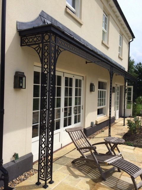Traditional and Modern Style Metal Georgian Veranda with Leaded Roof Frame, Cast Shoe Cover and Spandrel Brackets providing a Sun Shade over Large French Doors
