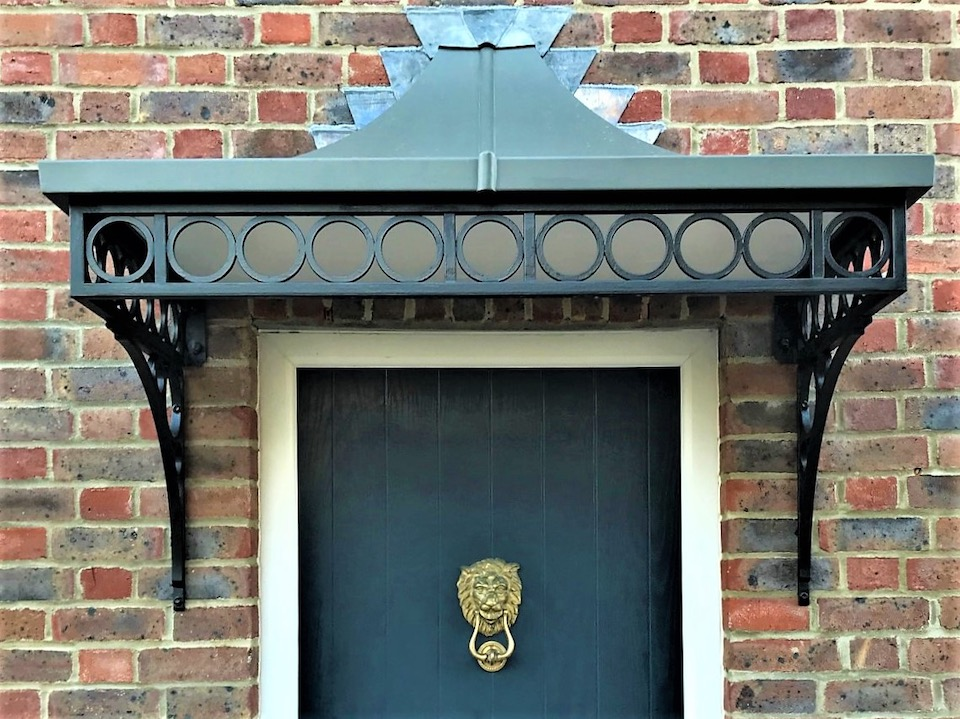 Traditional Victorian style ironwork Front Door Canopy cover with ring spandrels and complete zinc roof flashed in with lead