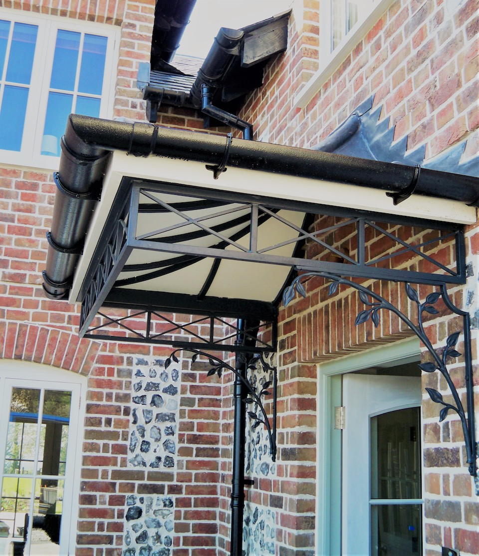 Custom Bespoke Design Front Entrance Canopy with Leaded Roof  and Cast Iron roseleaf design spandrel brackets