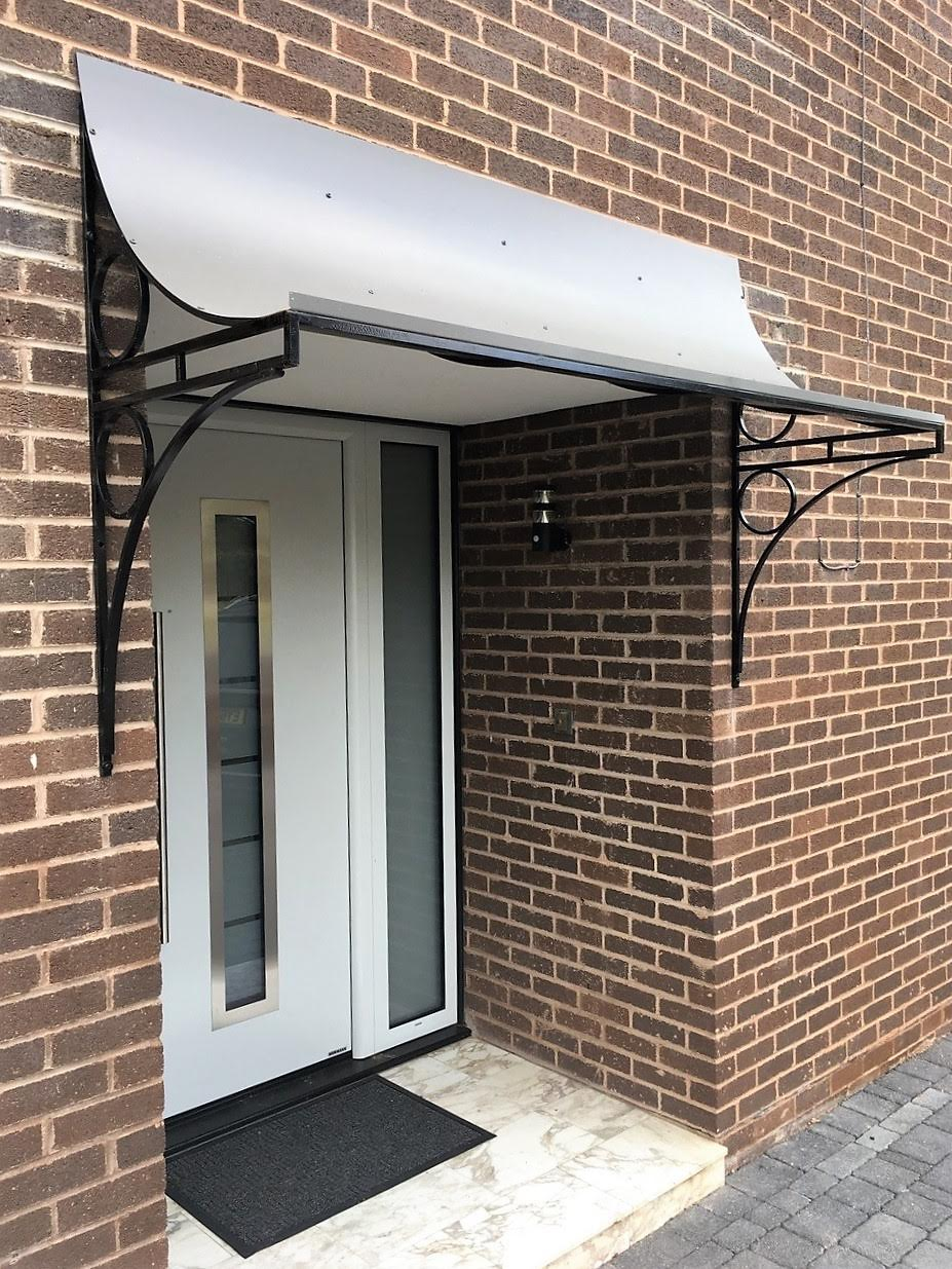 Glazed Wrought Iron Victorian style Ring Canopy with decorative spandrel brackets